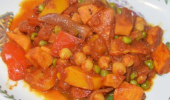 chickpea, sweet potato, pepper and pea curry on a plate