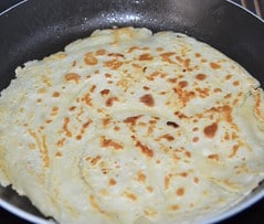 pancake cooking in pan