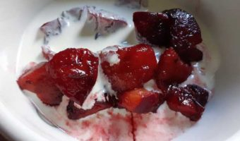 red-stewed-plums-in-bowl-with-cream
