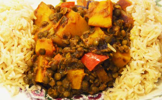 plate of showing colourful orange squash colours with lentils on a bed or rice