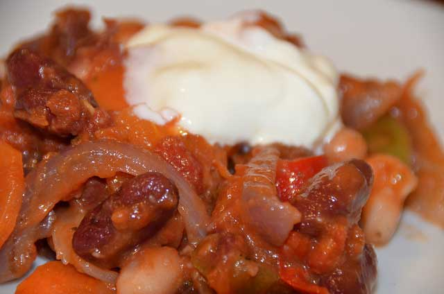 Portion of Chilli Bean with sour cream on top