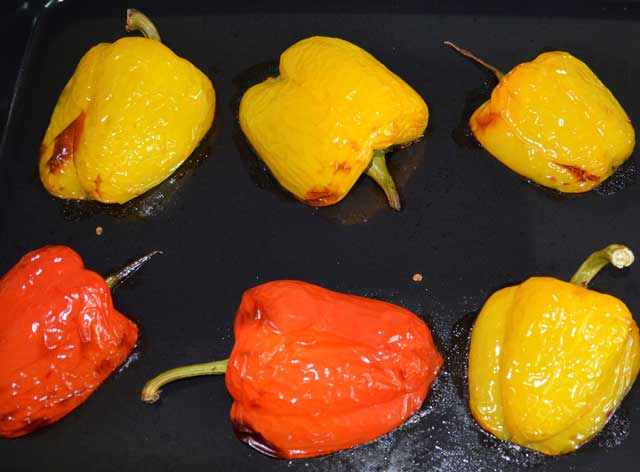 yellow and red pepper halfs on a baking tray