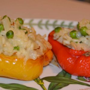 red and yellow half pepper stuffed with rice and peas