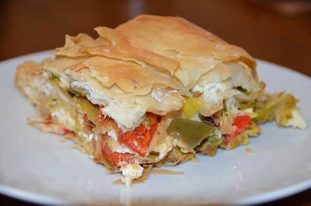 Delicious pie with filo pastry, cheese and peppers
