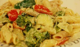 vegetables in a creamy sauce on a bed of penne pasta