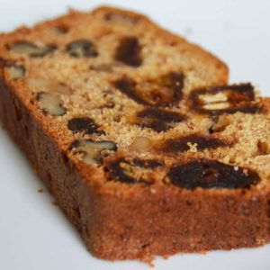 slice of cake showing dates and walnuts in the cake