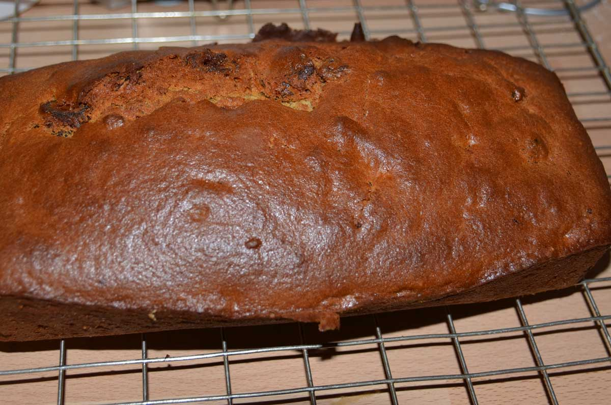 whole date and walnut loaf on cooling rack