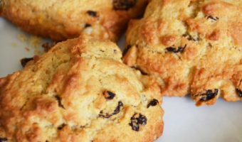 three rock cakes with sultanas on a plate