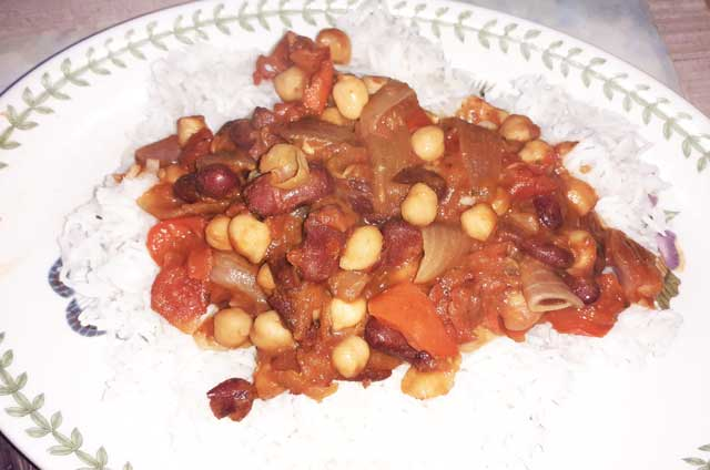 chickpeas, kidney beans with onions and pepper on a bed of rice
