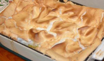 whole apple meringue in a baking dish