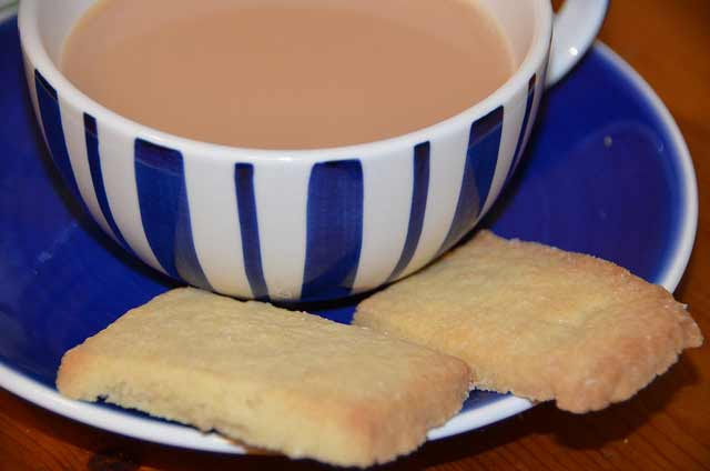 Shortbread bicuits in a cup and saucer