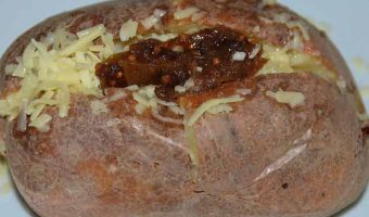 jacket potato filled with cheese and pickle