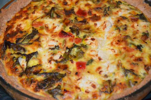 Kale, pepper and feta cheese in a quiche