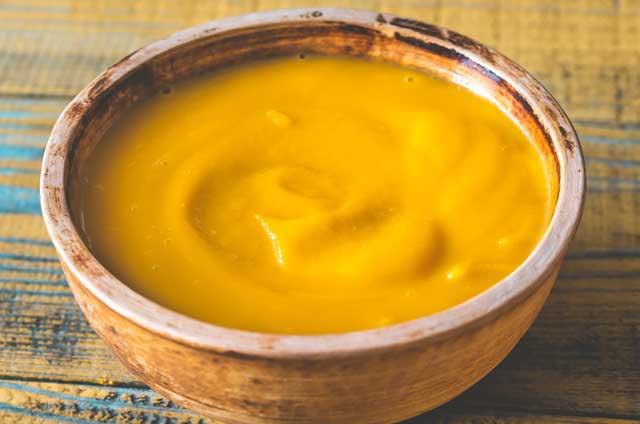orange colour soup in a bowl