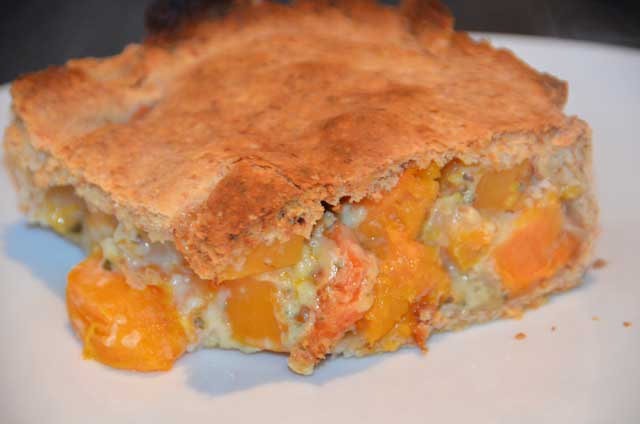 Piece of wholemeal pastry filled with squash, carrot and swede in an onion sauce