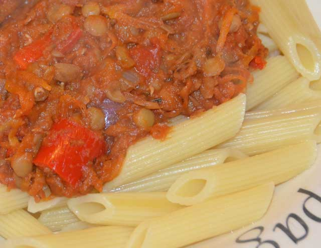 lentil bolognese tomato sauce on a bed of penne pasta