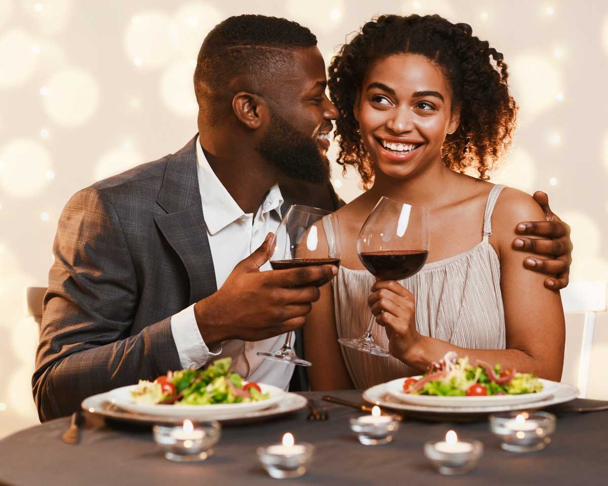 man and woman sharing a romantic meal