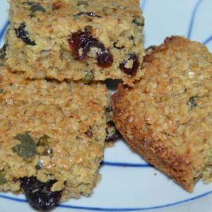 three-squares-flpajacks-on-plate-showing-fruit-seeds