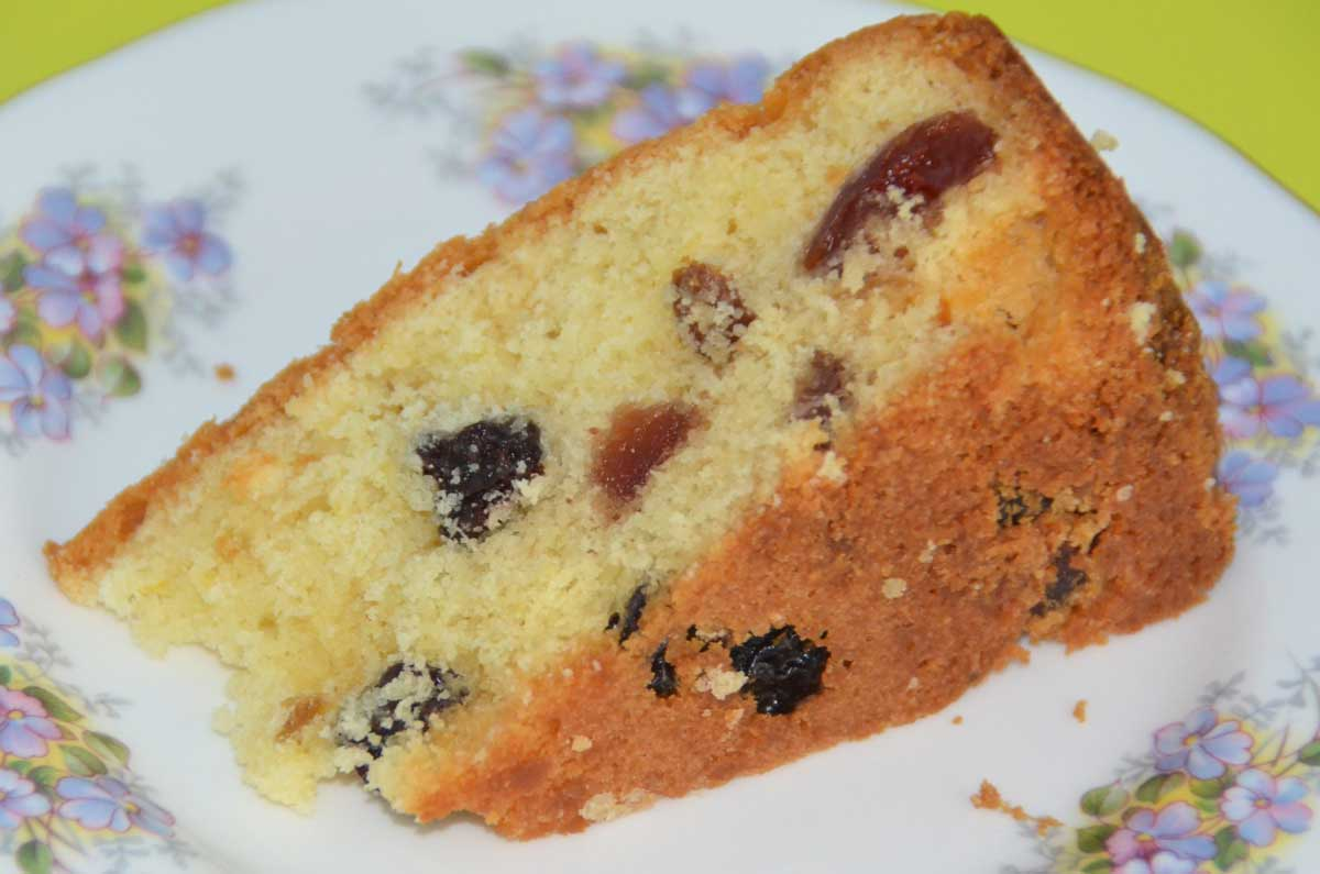 single slice-fruit and lemon cake showing fruit pieces