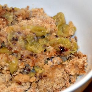 portion of stewed green gooseberries with crumble topping