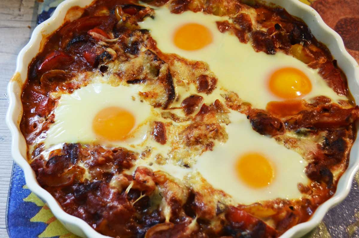 four eggs in a tomato and pepper sauce