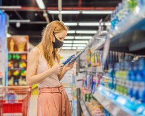 woman in shop wearing mask