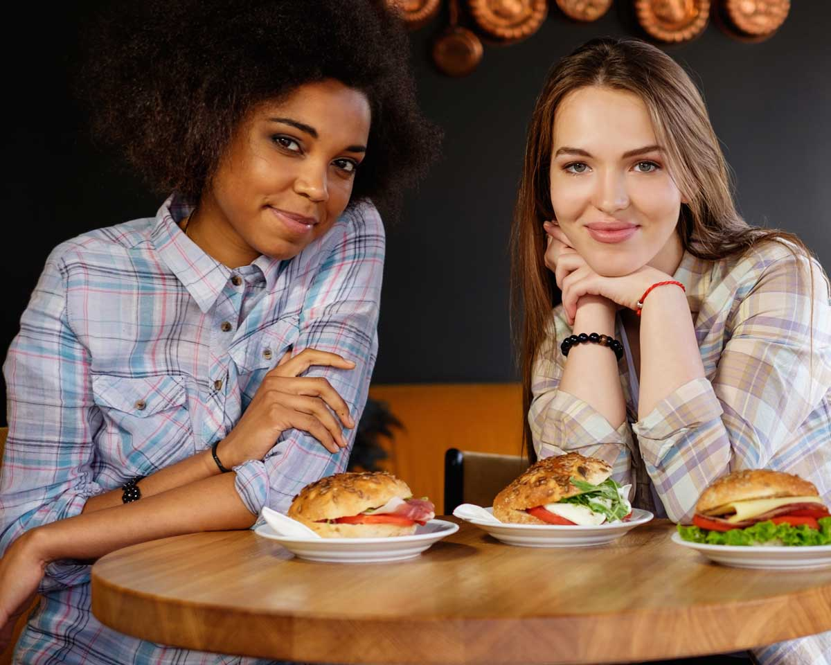 two women in cafe with food