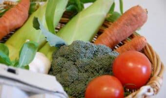 basket of fresh vevegtables including leek and broccoli