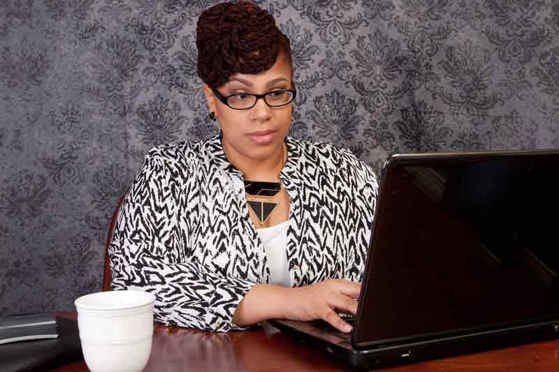 woman working with laptop and cup of coffee